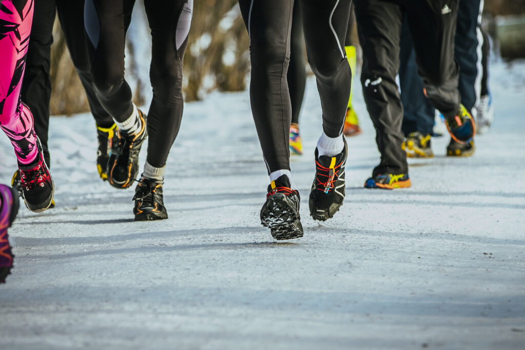 A group of runners running in the cold.